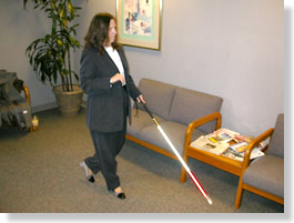 Picture of blind worker is walking in the office